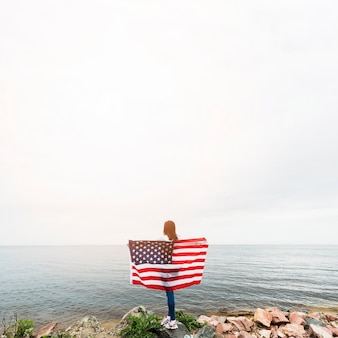 Independence day concept with woman at the sea