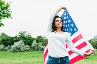 Independence day concept with woman holding american flag