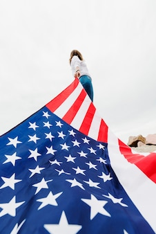 Independence day concept with woman pulling american flag