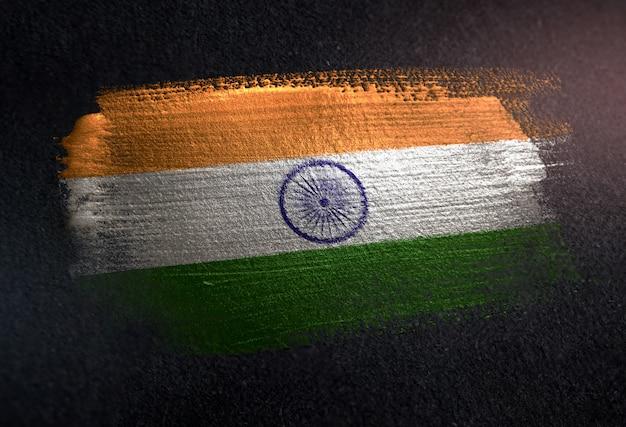 India flag made of metallic brush paint on grunge dark wall