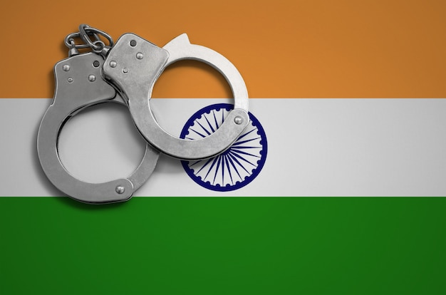 India flag  and police handcuffs. the concept of crime and offenses in the country