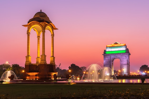 The india gate and the canopy, night illuminated view, new delhi, india.