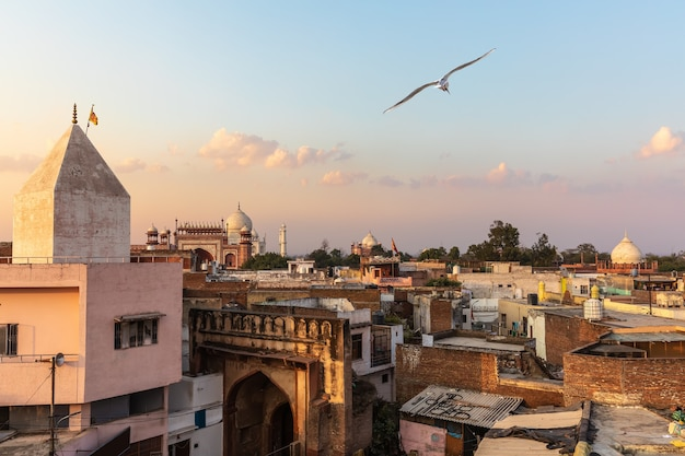 India, view on poor city agra and taj mahal in the background.