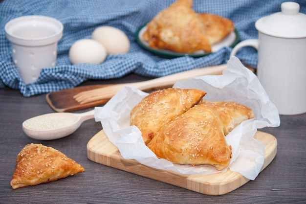 Indian, asian food delicious samsa or samoses on wooden background.