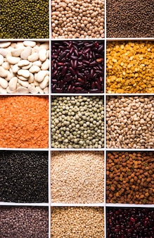 인도 콩, 펄스, 렌즈콩, 쌀, 밀 곡물은 세포가 있는 흰색 나무 상자에 있고 선별적인 초점을 맞춥니다.