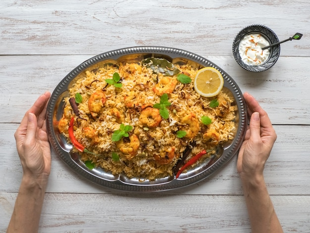 Indian biryani with shrimp. tasty and delicious prawns biryani, top view