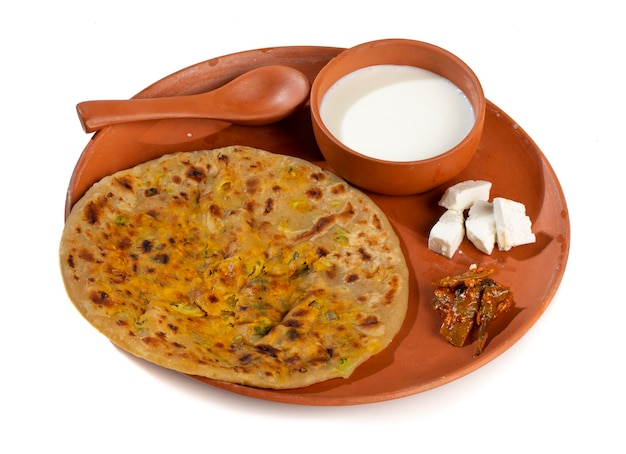 Indian breakfast dish paneer paratha serve with curd or chutney