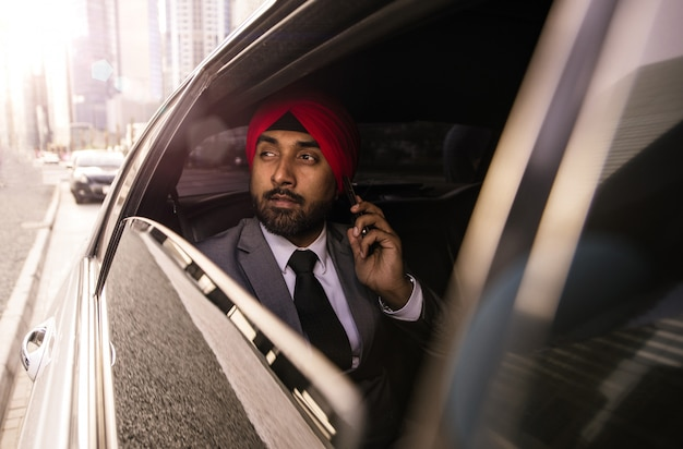Indian businessman his  company car in india