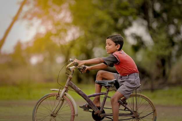 Indian child on bicycle