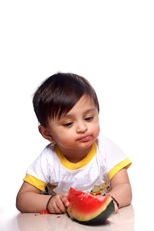 Indian child eating watermelon