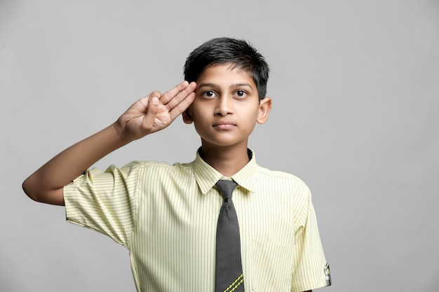 Indian child giving salute. independence day celebration concept.