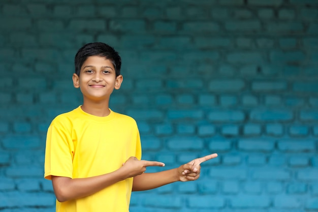 Indian child showing direction with hand