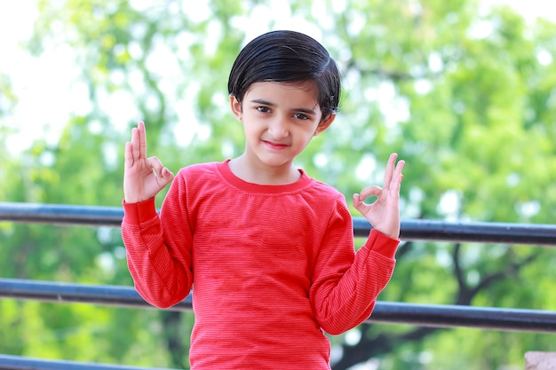Indian child showing nice gesture with hand