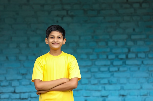 Indian child in t shirt and giving expression