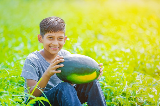 Indian child at watermelon field