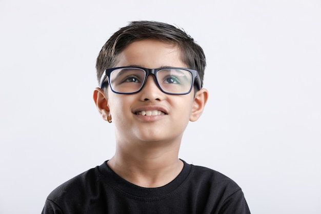 Indian child wearing spectacles and looking seriously