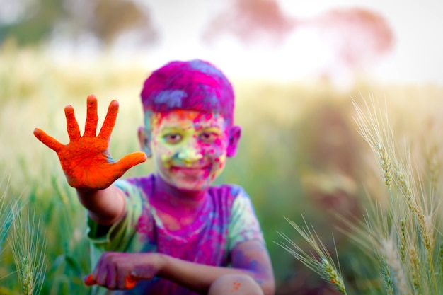 Indian children's playing with the color in holi festival