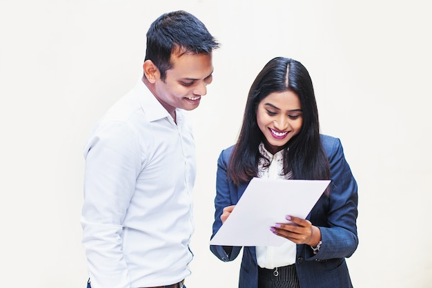Indian colleagues discussing a document