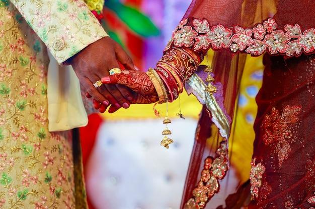 Indian couple hand in wedding satphera ceremony in hinduism