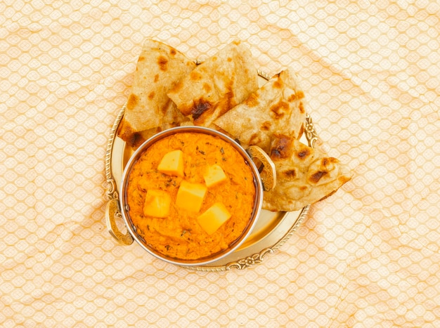 Indian cuisine cheese butter masala served with tandoori roti