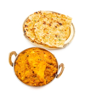 Indian cuisine sweet and spicy paneer pasanda served with garlic naan on white background