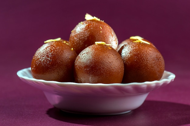 Indian dessert : gulab jamun in white bowl