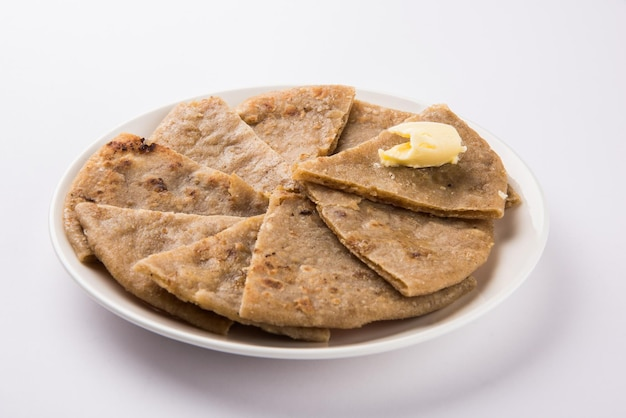Indian dessert sweet hot mawa or khoya or khova roti with ghee also known as khavyachi poli in marathi, served in a plate over colourful or wooden background. selective focus