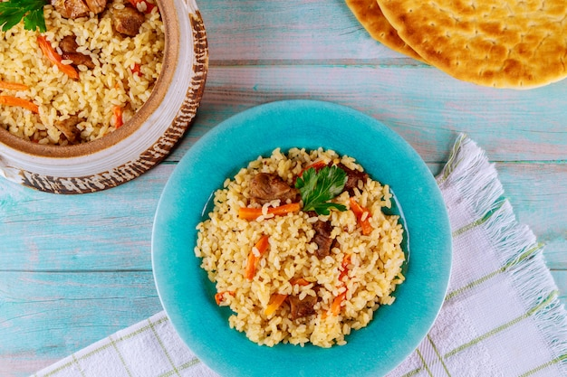 Indian dish rice with curry, meat and pita bread
