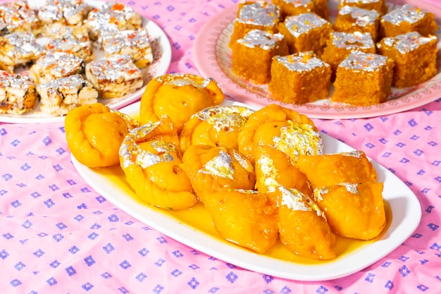 Indian diwali sweet food chandrakala with sugar free dry fruits, mung dal chakki and sweet samosa