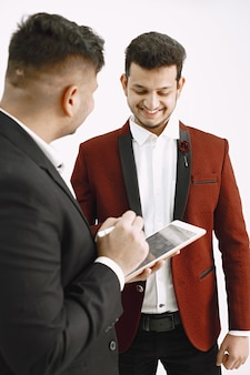 Indian executives working on project. man with tablet showing something to his collegue.