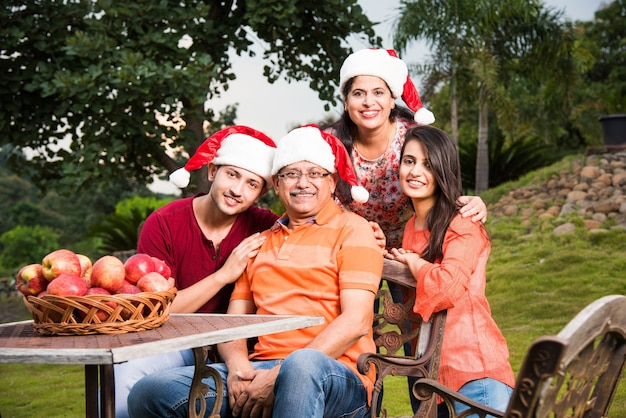 Indian family celebrating christmas and posing for a group photo