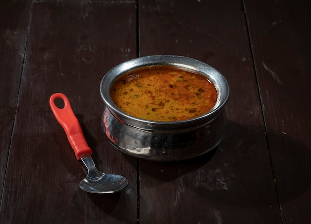 Indian famous cuisine dal tadka on vintage wooden background