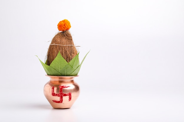 Indian festival akshaya tritiya concept : decorative kalash with coconut and leaf with floral decoration