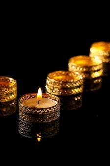 Indian festival diwali, candles on black