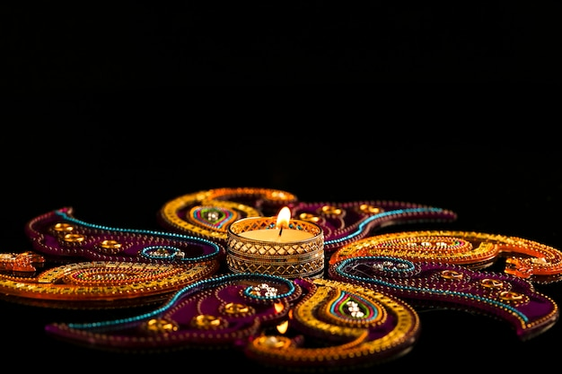 Indian festival diwali, candles on dark
