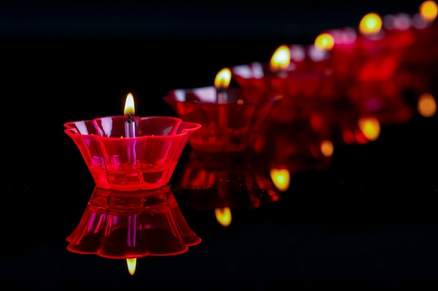 Indian festival diwali, colorful lamps of oil on black