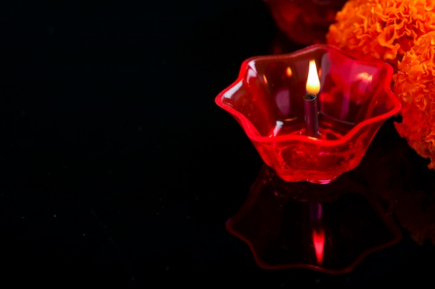Indian festival diwali , colorful lamps of oil on dark background