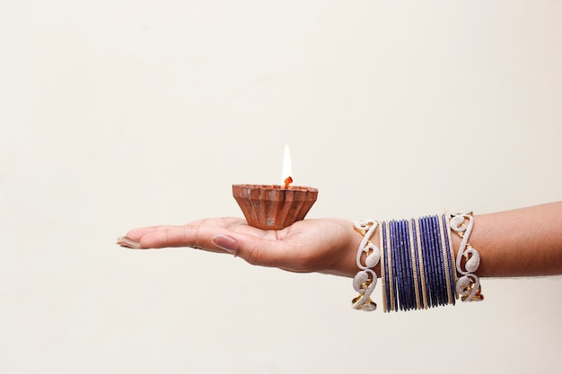 Indian festival diwali, lamp in hand