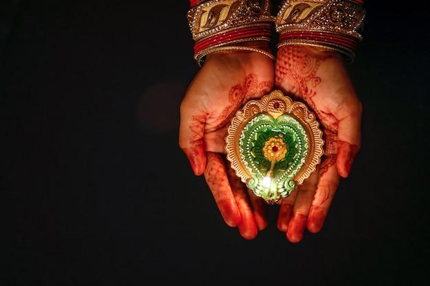 Indian festival diwali, lamp in hand