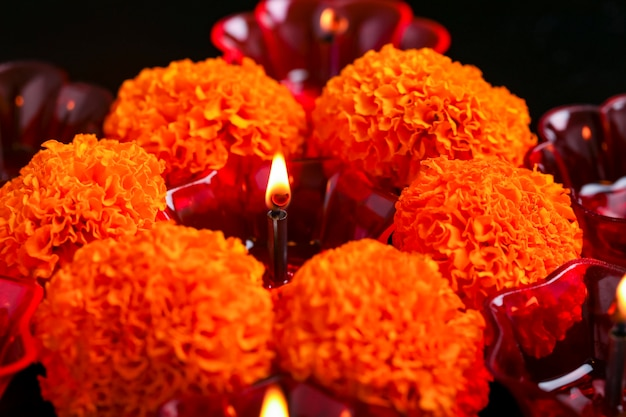 Indian festival diwali ,marigold flower and colorful lamps of oil on black background