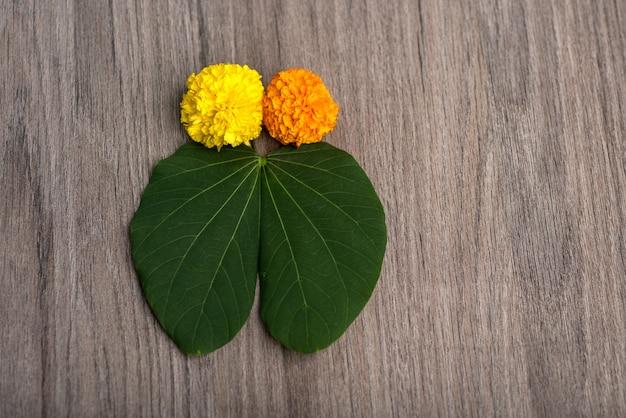 Indian festival dussehra background showing leaf and marigold flowers