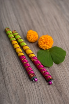 Indian festival dussehra and navratri with marigold flowers and dandiya sticks