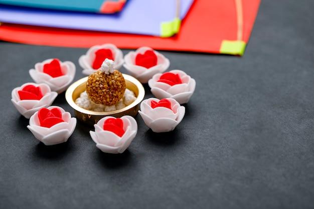 Indian festival makar sankranti concept, sesame seed ball and tilgul