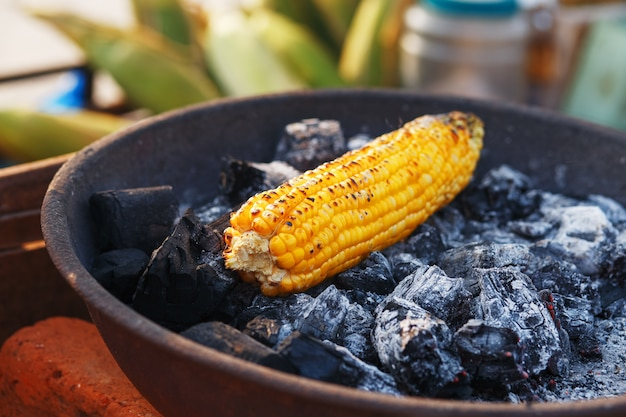 Indian food on the beach - fresh corn cobs are roasted on the coals.