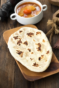Indian garlic naan bread on wooden