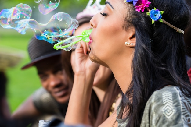 Indian girl blowing soap bubbles