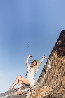 Indian girl on the roof. dream catchers. beautiful blonde girl with dream catchers.