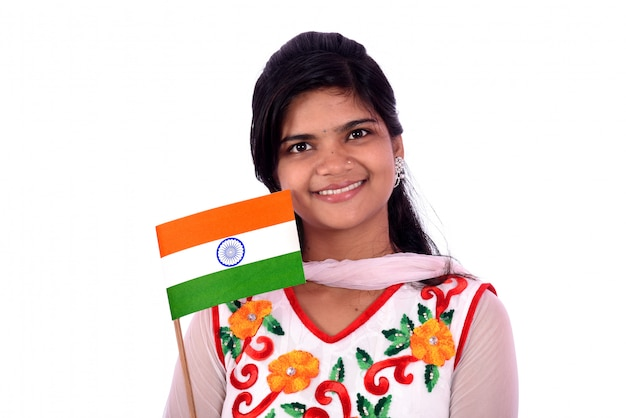 Indian girl standing with indian flag or tricolor on white background, girl holding indian flag, indian independence day, indian republic day