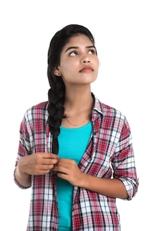 Indian girl thinking on a white wall