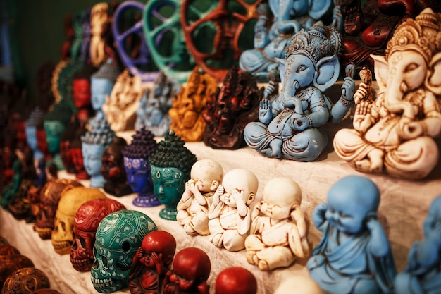 Indian gods souvenirs on the counter of the night market for tourists